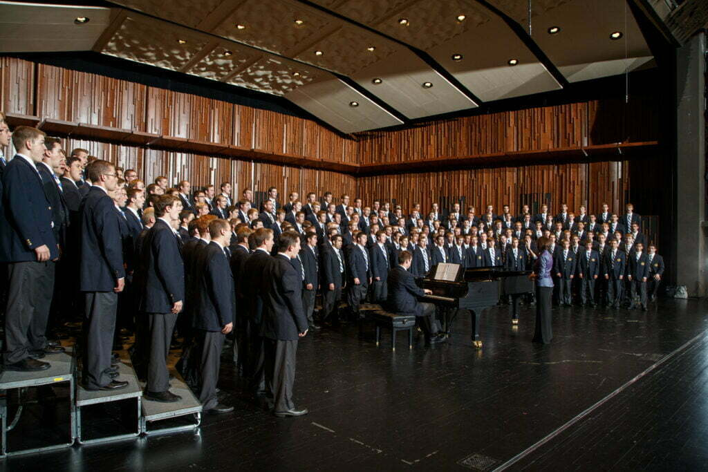 1209-42 348.CR2  Men's Chorus on the deJong stage Rosalind Hall, director  Choir, Conductor, Conducting, Piano accompaniment, Onstage, Singing.  September 22, 2012  Photography by Mark A. Philbrick  Copyright BYU Photo 2012 All Rights Reserved photo@byu.edu  (801)422-7322